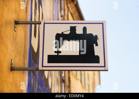sign board for shop repairing clothes - Stock Photo