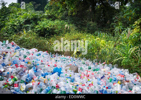 Empty plastic bottles piled up in a park at on of the major tourist attractions in Zhanjiajie, China 2014 - Stock Photo