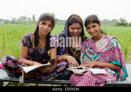 indian rural mother and  Daughter study - Stock Photo