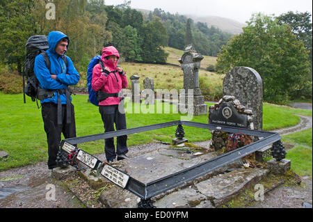 Hikers visiting Rob Roy's Grave - Stock Photo