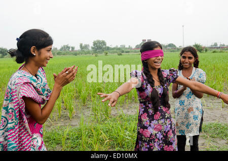 indian girls farm playing Hide and Seek - Stock Photo