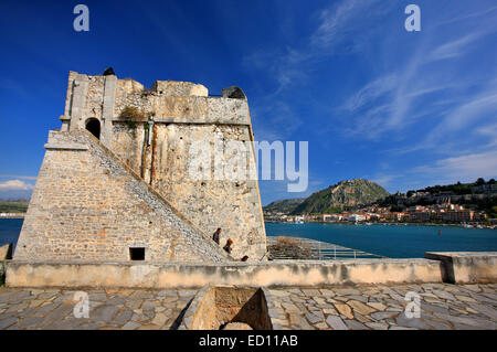 Inside view of Bourtzi castle upon a tiny island, with Nafplio town and Palamidi castle in the background,  Greece - Stock Photo