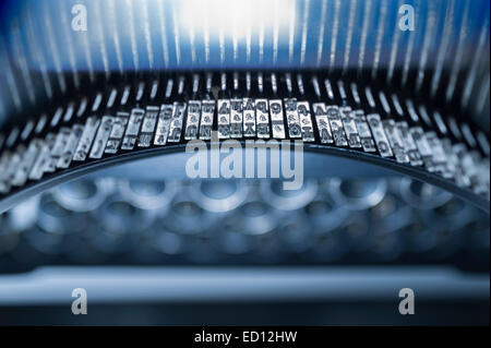 Antique typewriter keys and type with limited depth of field - Stock Photo