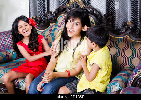 indian mother with children fun - Stock Photo