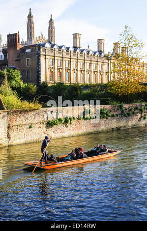 Punting in autumn on the river Cam with Clare College in the background, Cambridge Cambridgeshire England United - Stock Photo