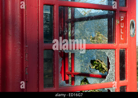 A vandalized telephone box in rural cornwall, uk - Stock Photo