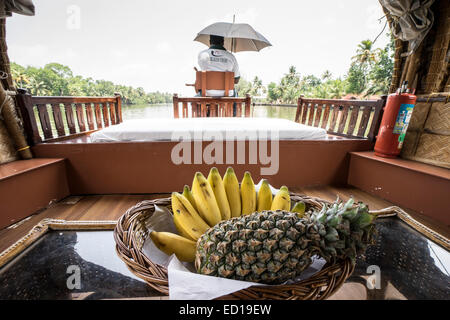 Kerala, India - Nedumudy. Boarding for houseboat trips. Fruit set out on board. - Stock Photo