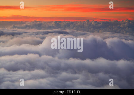Clouds at sunset from near the top of Haleakala, Haleakala National Park, Maui, Hawaii. - Stock Photo