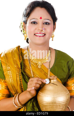 1 South  indian Lady saving money Piggy Bank - Stock Photo