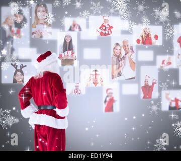 Composite image of santa looks away from the camera - Stock Photo