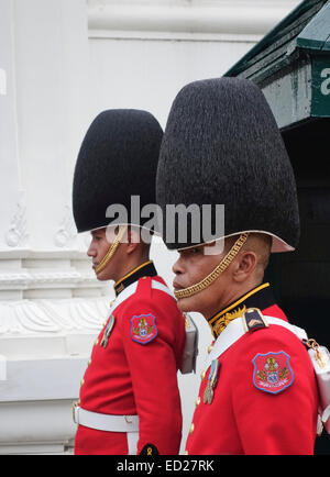 Royal Thai Army guards at their quarters at tourist attraction the Grand Palace in Bangkok, Thailand. - Stock Photo