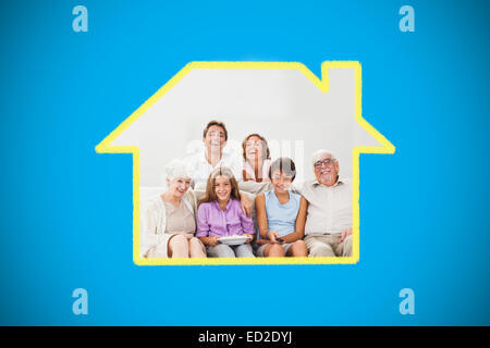 Composite image of multigeneration family on couch watching tv - Stock Photo