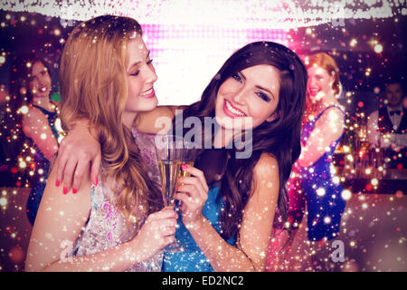 Composite image of friends drinking champagne