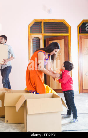 indian Parents and son Home Shifting - Stock Photo