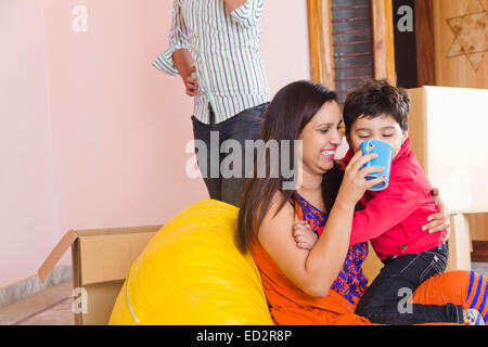 indian Parents and son Feeding milk - Stock Photo