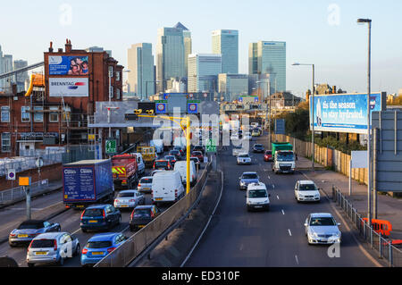 Traffic on A102 Blackwall Tunnel Approach with Canary Wharf skyscrapers in the background, London England United - Stock Photo