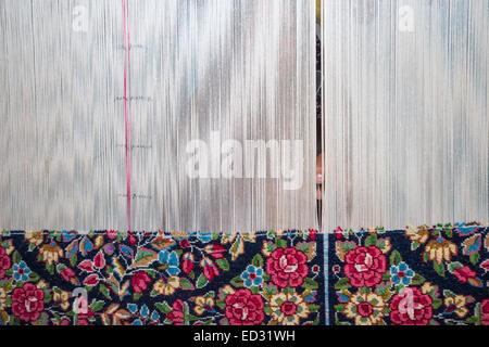 Carpet weaving, city of Ravar, Kerman, Iran - Stock Photo