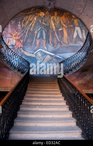 The Palacio de Gobierno occupies a former seminary and is boldly decorated with murals that reflect both the history - Stock Photo