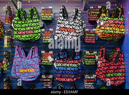 Colorful New York City tote bags for sale at the Toys Are Us store in Times Square in MIdtown Manhattan, New York - Stock Photo