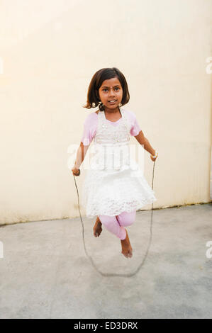 1 indian child girl Skipping Rope - Stock Photo