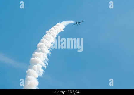 Single member of the Italian Air Force Frecce Tricolori aerobatic display team trailing white smoke in a steep climb - Stock Photo