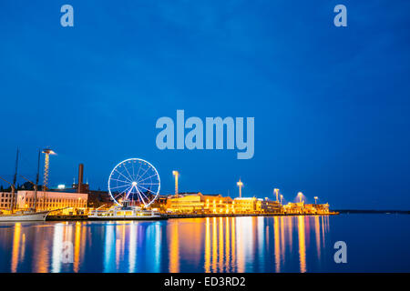 Night Scenery Panoramic View Of Embankment With Ferris Wheel In Helsinki, Finland - Stock Photo