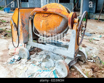 Old cement mixer machine in the construction site. - Stock Photo