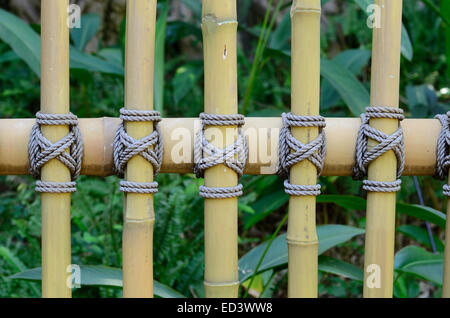 beautiful Thai stye bamboo fence connect by rope - Stock Photo