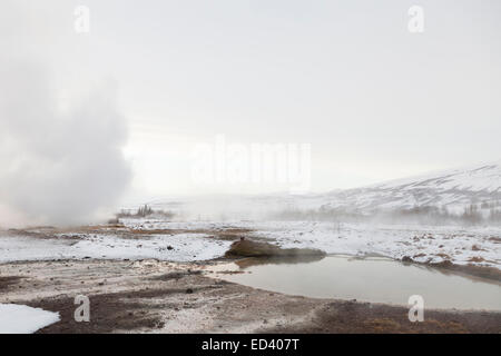 Hot springs in the geothermal area of Haukadalur, Iceland - Stock Photo