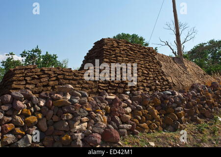 Pile of dung being dried for fuel in a village between Ani and Kars in the remote arid part of north-east Turkey - Stock Photo
