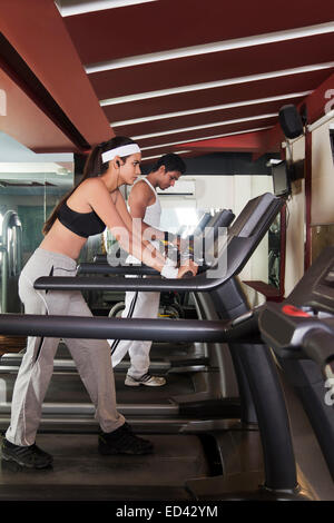 2 indian sports boy and lady tread Mill  Running - Stock Photo