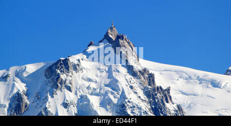 The Aiguille du Midi (3,842 m) is a mountain in the Mont Blanc massif in the Alps with a panoramic viewing platform - Stock Photo