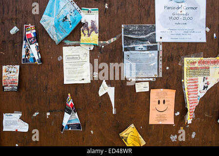 some announces affixted on a wood table - Stock Photo