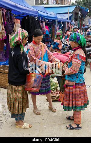 Flower Hmong girls at Sunday Market, Bac Ha, Sapa (Sa Pa), Vietnam - Stock Photo