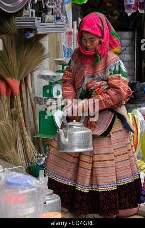 Flower Hmong woman at Sunday Market, Bac Ha, Sapa (Sa Pa), Vietnam - Stock Photo