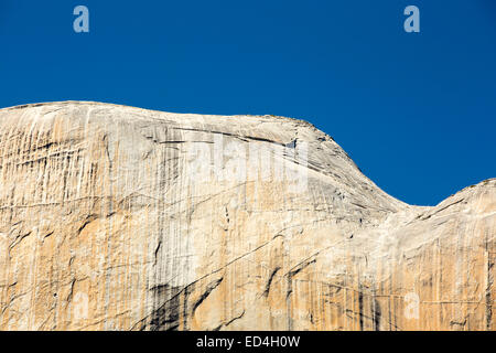 Hikers climbing Half Dome in Yosemite, California, USA. - Stock Photo