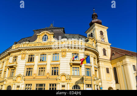 Architecture details of City Hall in Large Square, Sibiu downtown, medieval city of Transylvania, Romania. - Stock Photo