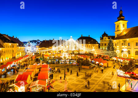 SIBIU, ROMANIA - 20 DECEMBER 2014: Night image with tourists at Christmas Market in Great Market of medieval Sibiu, - Stock Photo
