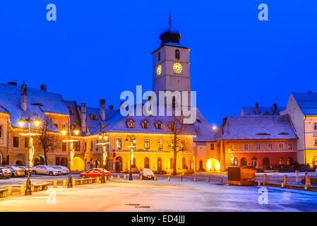 Sibiu, Romania. Twilight image of Council Tower in Small Square, downtown of Sibiu, Transylvania. - Stock Photo