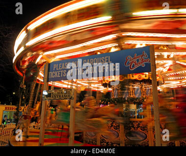 Traditional fairground attractions at Night at Edinburgh's Hogmanay - Stock Photo