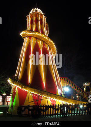 Traditional fairground attractions, the big slide  at Night at Edinburgh's Hogmanay - Stock Photo