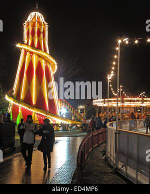 Traditional fairground attractions at Night at Edinburgh's Hogmanay Scotland - Stock Photo
