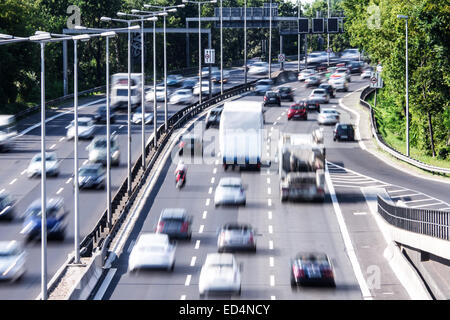 cars on highway in late afternoon - Stock Photo