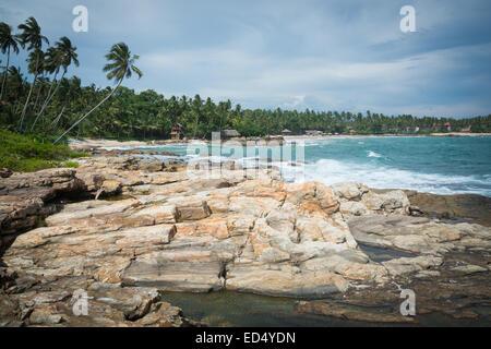 Rocky landscape at Rocky Point beach, Goyambokka, Tangalle, Southern Province, Sri Lanka, Asia. - Stock Photo