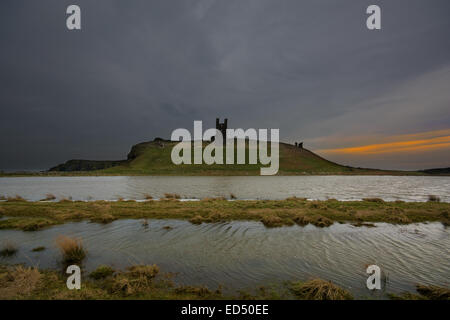 Dunstanburgh Castle on the Northumberland coast some 2 miles from Craster. - Stock Photo