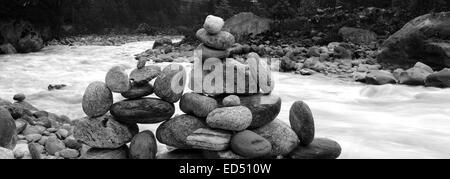 Buddhist Prayer Stones by the side of the Dudh Koshi river, Phakding village, Sagarmatha National Park, Solukhumbu - Stock Photo