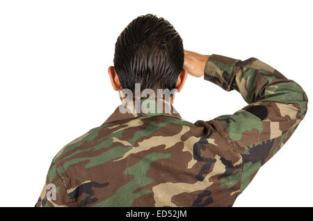 rear view of man in military uniform saluting - Stock Photo