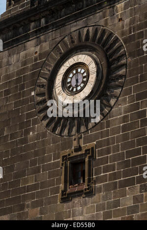 A clock on the steeple of the Cathedral of Puebla, a 16th century, Roman Catholic Church, in Puebla, Mexico - Stock Photo