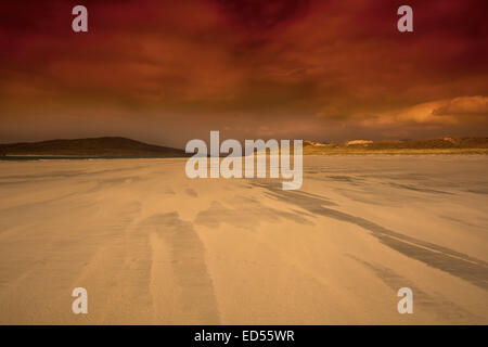 A golden sunset on Luskentyre on the Isle of Harris in the Outer Hebrides, Scotland - Stock Photo