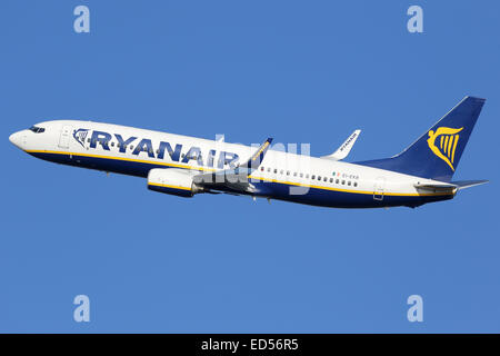 Barcelona, Spain - December 11, 2014: A Ryanair Boeing 737-800 with the registration EI-EKB taking off from Barcelona - Stock Photo